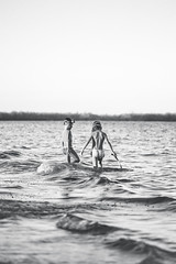 Sister and brother (Top KM) Tags: landscape travel summer children water black white sea ocean waves beautiful child island tanzania coast outdoors swim zanzibar journey childhood siblings swimming time photos bw sister brother two kids