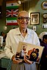 Boman Kohinoor, 96 years old owner of Cafe Britannia, Mumbai (Yekkes) Tags: asia india mumbai bombay fort cafebritannia nostalgia age vitality pride devotion cafe parsi iranicafe flags smile people tradition bomankohinoor