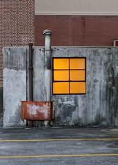 hideaway (jim_ATL) Tags: night rooftop parking garage window yellow light concrete brick wall pipe vent atlanta