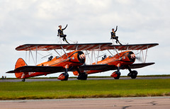 Wing Walkers (Bernie Condon) Tags: breitling wingwalkers girls ladies aerobatics wingwalking aerosuperbatics boeing stearman trainer vintage classic preserved aircraft plane biplane scampton rafstation military aribase base station airshow 2017 flying display uk lincs royalairforce raf