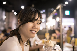 Japanese woman eating burrito for lunch