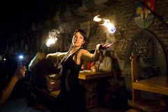 Fire Dancer (Erik de Klerck) Tags: dark dancer fire firedancer dance light restaurant budapest medieval flame flames girl woman hungary nikon 24mm 14g sir lancelot sirlancelot