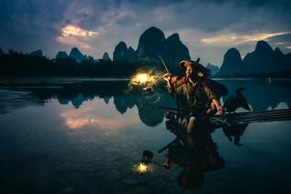 Fisherman in Guilin ( Guangxi , China )