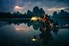 Fisherman in Guilin ( Guangxi , China ) (pascal-k) Tags: asia china guangxi xingping yangshuo bird cormoran fisherman karst mountain night river travel