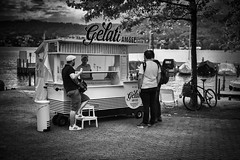 gelati am see (sonofphotography) Tags: sonofphotography tsphotoart blackandwhite bw street portrait leicasl zeisssonnar 50mm streetart light shade shadow availablelight zurich lake icecream gelati summer