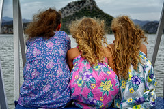Three Ladys Moving Mountains (Alfred Grupstra) Tags: women people outdoors summer smiling youngadult lifestyles sea friendship females beach happiness vacations cheerful relaxation adult fun sitting curlyhair montenegro skadarlake