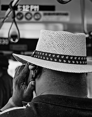 AT 1:12PM, SOME WHERE, SOME PLACE, SOME ONE HAS THIS SAME VIEW THAT I DO. (panache2620) Tags: man hat blackman black afroamerican eos canon urban bus publictransportation photojournalism documentary metro metrotransit monochrome bw