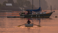Smoky Sunset Rower (Paul Rioux) Tags: marine waterfront ocean sea cowichanbay bc sunset evening dusk smoke haze orange boat row girl person calm water reflections prioux sparkle