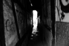 It's getting tight (Leica M6) (stefankamert) Tags: stefankamert street tight blur alley noir noiretblanc bw baw bnw blackandwhite blackwhite schwarzweis leica m6 leicam6 voigtländer nokton 35mm film analog grain ilford fp4