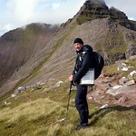 Me on Stob Cadha Gobhlach, with Corrag Bhuidhe behind thumbnail