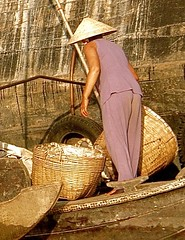 Magical Places and Things- The Mekong (3) (The Spirit of the World ( On and Off)) Tags: vietnam southeastasia indochina asia themekong river mekongriver commerce riverscene local bamboobaskets market floatingmarket boats hull