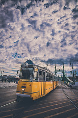 The tram No 49 in Liberty bridge (Vagelis Pikoulas) Tags: travel tram liberty bridge budapest autumn blue canon clouds colour cloud cloudy city cityscape colours color colors capital day danube europe eos full frame hungary holidays landscape old pest reflection river sky sun tokina view yellow