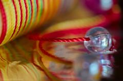 puerh pick (sure2talk) Tags: macromondays memberschoicefoundinthekitchen foundinthekitchen memberschoice kitchen puerhpick reflection blur texture colourful beads foil kitchenfoil shallowdof macro closeup hmm nikond7000 nikkor85mmf35gafsedvrmicro explore