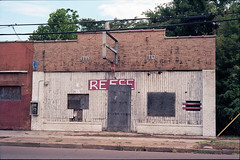 What's left of Reese (ADMurr) Tags: dab143 ms clarksdale 4th street mlk st shuttered bar club red sign brick plywood leica m6 kodak 50mm summicron documentary boarded window