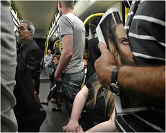 catching her AS the news (gerhardkörsgen) Tags: atmosphere alltag candid city cologne colour decisivemoment everyday face gerhardkoersgen germany gesicht humour indoor körsgen köln life look menschen newspaper people perspective photographed passengers streetphotography scene travel tram urban ubahn metro subway view crowd surreal
