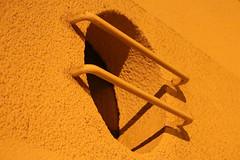 D'une lucarne barreaudée... (Pi-F) Tags: nuit fréjus provence lumière lucarne rond cercle barreau jaune éclairage ombre géométrie architecture façade fenêtre texture crépi
