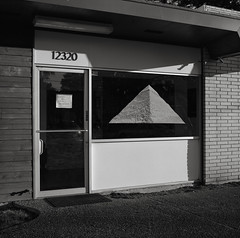 Pyramid, Beaverton (austin granger) Tags: pyramid beaverton oregon egypt place triangle storefront symbol sign geometry meaning mind film signifier tomb