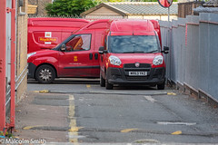 Waiting To Deliver (M C Smith) Tags: pentax k3ii road drive vans red post delivery railings speedhumps gates metal barbedwire garage yellow trees green buildings mirror