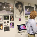 A student presenting his photography at the capstone presentation.