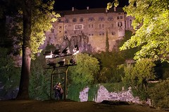 Enjoying the view and each other (Jumpin'Jack) Tags: people couple man woman lovers embrace hug standing upon island river vltava admiring steep hill medieval castle hrad zamek český krumlov town czech republic windows trees green ivy covered wall spot flood light street lamp night shot long exposure
