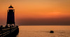 Sundown (T P Mann Photography) Tags: boat shine reflections shadows eos tamron digital dslr canon puremichigan pure low dusk horizon seascape sea river channel charlevoix michigan lake railing fence pier silhouette sky golden orange sunlit sundown sunset sun lighthouse light