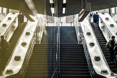 Going Up (Sean Batten) Tags: london england unitedkingdom gb tottenhamcourtroad tube subway metro underground escalator stairs people city urban nikon df 58mm reflection