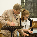 DSCN8691c John Gibbons, conductor and Jess Gillam, Saxophone rehearsing Concerto for Saxophones by Barbara Thompson. 28th September 2017. thumbnail