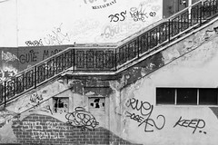 Bucharest in Black and White (virtualwayfarer) Tags: romania bucharest europe capital blackandwhite architecture downtown streetphotography design citystreets graffiti decay decaying stair stairway chippedpaint