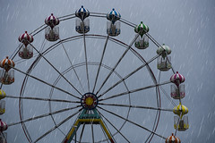 """Wish you were here?"" (A British Postcard) (Michelle Tuttle) Tags: skegness fair fairground bigwheel ride wheel eye colours bright rain summer seaside town british britishsummer gloomy dismal depressing raining shower storm lincolnshire"
