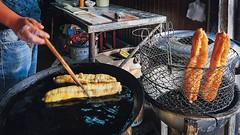 Frying youtiao. Xitang water town, Zhejiang, China (roamscapes) Tags: food chinese china dough youtiao fritters cooking