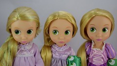 2010, 2017 and 2011 Rapunzel Toddler Dolls - Standing Side by Side - Portrait Front View (drj1828) Tags: dac disneystore disneyanimatorscollection 2017 rapunzel tangled 16inch toddler nightgown lavender deboxed 2011 2010 sidebyside comparison doll posable