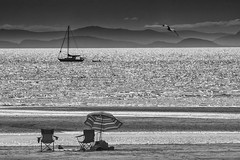 Summertime (jbarc in BC) Tags: summer summertime beach sand ocean tide umbrella chairs sail sailboat sea mountains seagull boat bc britishcolumbia vancouver tidal whiterock