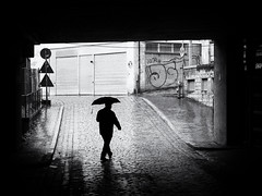 rain (Sandy...J) Tags: olympus atmosphere alone blackwhite bw monochrom man rain urban underpass umbrella street streetphotography noir black white walking darkness germany silhouette