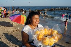 Mangoes (dtanist) Tags: nyc newyork newyorkcity new york city sony a7 konica hexanon 40mm brooklyn coney island beach shore sand labor day seller selling mango mangoes