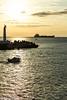 Sortie matinale (Thierry Poupon) Tags: cargo lumière mer méditerranée navire orange phare portlanouvelle reflet soleil barque bateau ciel contrejour lever leverdesoleil nuages languedoc france fr