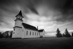 God loves a liar. (Fistfulofpowder) Tags: springlake alberta church nikon d300s tokina 1116mm long exposure time slow shutter speed bw black white mono monochrome trees building history steeple windows tower clouds cloudporn sky skyporn streak streaks streaking spring lake st boniface catholic architecture cemetery strome killam flagstaff county rosalind kelsey heisler forestburg range road twp secondary highway dirt roads exploring rurex rural urbex urban religion religious faith slik nd filter daytime awesome natural light neutral density big stopper 10stopndfilter thephotoargus yegphotographer