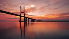 Vasco de gama on fire (sgsierra) Tags: dario vasco de gama cumpleaños amanecer naranja puente bridge arquitectura