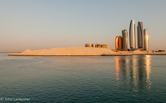 The sun rises on further progress in Abu Dhabi (Jhopne) Tags: canonef2470mmf28lusm canoneos5dmarkii water sky sea sunset building city