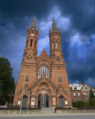 Church in Tarnow, Poland (Cat Girl 007) Tags: outdoor brick tower medieval cathedral historical travel culture landmark architectural unique history poland outside old spiritual traditional building faith religious historic church tradition architecture city catholic tourism religion ancient monument christianity structure europe exterior facade landscape verticalview tarnow