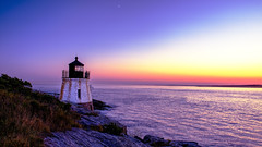 Castle Hill Lighthouse at Sunset with Crescent Moon (iecharleton) Tags: castlehilllighthouse castlehill lighthouse sunset moon bluehour sea bay narragansettbay shore coast seascape cliff rock rocky sky architecture nautical newport rhodeisland newengland northeast