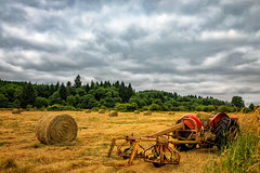 Rolls in the Hay (KPortin) Tags: tractor clouds field hay pacificcounty