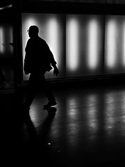 Walking by (andersåkerblom) Tags: streetphotography streetphoto street walking silhouette monochrome blackandwhite