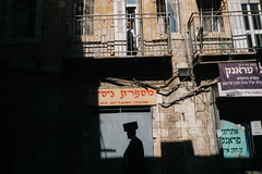 Jerusalem (f.d. walker) Tags: africa israel jerusalem middleeast palestine shadow shadows streetphotography street sunlight sun surreal candidphotography candid color colorphotography colors city children child man boy silhouette jewish judaism orthodox mea shearim
