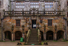 to the tea room (lowooley.) Tags: chillinghamcastle northumberland courtyard stairs cannon stocks signage