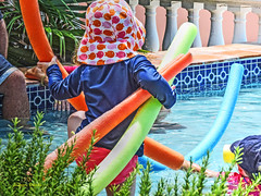 got noodles (albyn.davis) Tags: child humor vacation travel colors colorful bright vivid vibrant blue water summer hat people orange