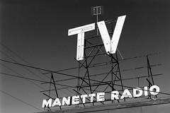 Manette Radio (bac1967) Tags: leicaiiia leicarangefinder leica elmarlens elmarltmlens leitzelmar5cmf35lens rodinal rodinal150 ferrania ferraniap30alpha ferraniap30 p30 puget sound pnw pacificnorthwest washington washingtonstate wa blackandwhite blackandwhitefilm black white bw monochrome monotone film kitsappeninsula kitsap kitsapcounty manette tv radio power powerlines manettewa sign antenae bremerton westbremerton