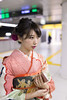 Young woman in Furisode kimono waiting for train at platform (Apricot Cafe) Tags: img5320 2024years 20s asia asianethnicity asianandindianethnicities healthylifestyle japan japaneseethnicity japaneseculture kimono sigma35mmf14dghsmart tokyo tokyojapan beautifulwoman beauty candid carefree celebration ceremony charming cheerful colorimage culture day enjoy enjoyment fashion furisode hairaccessory happiness holding lifestyles longhair obi oneperson onlyjapanese outdoors peaceful people photography platform portrait realpeople seijinnohi seijinshiki smartphone smiling standing subway sustainablelifestyle threequarterlength traditionalclothing trainstation vertical woman youngadult