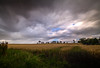 "storm coming, dramatic view from Tolquhon Castle across wheat fields of Aberdeenshire, Scotland (grumpybaldprof) Tags: canon 7d ""canon7d"" sigma 1020 1020mm f456 ""sigma1020mmf456dchsm"" aberdeenshire scotland ""tolquhoncastle"" tolquhoun pitmedden castle stone chateau renaissance ""preston'stower"" forbes fineart colour storm drama mood moody atmosphere clouds wheat fields hdr countryside contrast threatening nd longexposure"