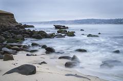 La Jolla Cove Morning (adamsarasin) Tags: lajolla sandiego morning wateroverrocks longexposure beach ocean water rocks cliff seal moss