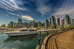 """Vancouver coal harbor bay. (wimvandemeerendonk, back home) Tags: vancouver harbor city cityscape moderncity canada britishcolumbia bright blue colours color colors colour clouds cloud cloudscape minolta monumental outdoors outdoor panorama reflection ripples sony sky sun ultrawide wimvandem water skyscraper topf100100149faves """"flickrtravelaward"""" ngc"""